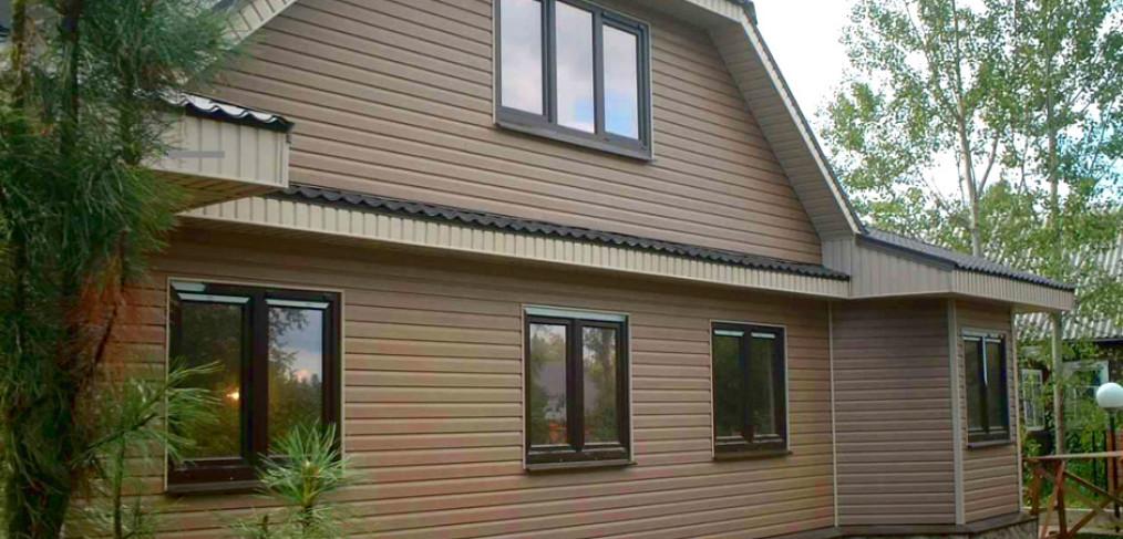 Наружная отделка деревянного дома панелями